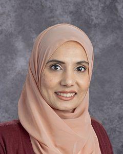 Woman wearing peach headscarf