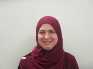 Smiling woman wearing maroon hijab (head scarf)
