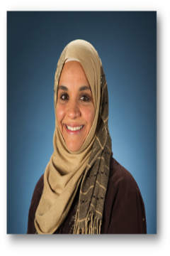 Smiling woman in beige scarf and brown top