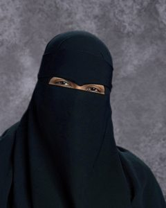 Woman in black headscarf and niqab