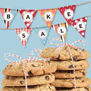 two stacks of chocolate chip cookies tied with red and white ribbon with bake sale sign above on banners