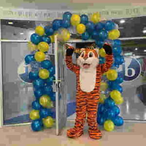 tiger mascot surrounded by blue and yellow walloons