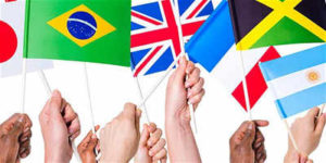 Children's hands holding flags from around the world